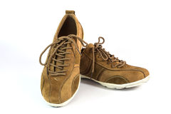 Brown suede sports shoes Royalty Free Stock Image