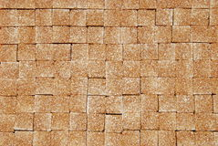 Brown sugar. Background of brown cubes of sugar Royalty Free Stock Photo