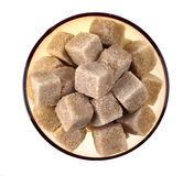 Brown sugar. Cubes in bowl on white background Royalty Free Stock Photos