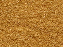 Brown sugar. Grains of brown sugar (usable as background royalty free stock images