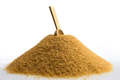 Brown sugar. With wooden spoon Stock Images
