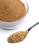 Brown sugar. Teaspoon of brown sugar, more sugar to the bottom royalty free stock photos