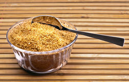 Brown sugar. Bowl with spoon royalty free stock photos