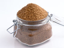 Brown sugar. In glass jar stock photography