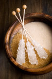Brown sugar. In the wooden bowl stock photos