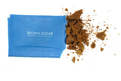 Brown sugar. Photograph of brown sugar in sachet royalty free stock photos