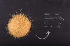 Brown sugar on black chalkboard Royalty Free Stock Photo
