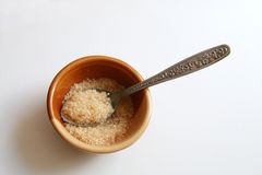 Brown sugar in the bowl. And tea spoon Royalty Free Stock Photos