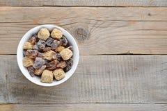Brown sugar in bowl Stock Photos