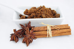 Brown sugar, cinnamon sticks and anise Stock Photos