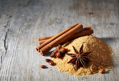 Brown sugar, cinnamon sticks and star anise Royalty Free Stock Photography