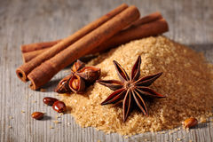 Brown sugar, cinnamon sticks and star anise Royalty Free Stock Photos
