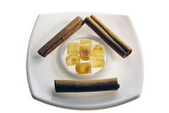 Brown sugar and cinnamon sticks still life Stock Images