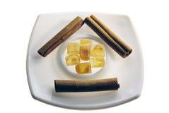 Brown sugar and cinnamon sticks still life Stock Images
