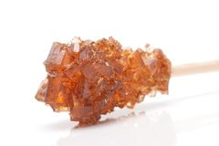Brown sugar crystal on wooden stick Royalty Free Stock Photography