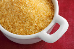 Brown sugar crystals in a bowl Stock Image