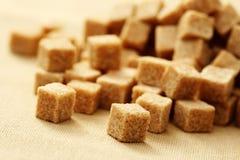 Brown sugar cubes Stock Images
