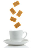 Sugar Cubes. Brown sugar cubes with coffee cup Stock Photography