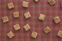 Brown sugar cubes pattern background. Top view. Diet unhealty sweet addiction concept Royalty Free Stock Images