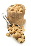 Brown sugar cubes in scoop on white Royalty Free Stock Photo