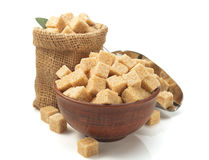 Brown sugar cubes on white Stock Photos