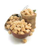 Brown sugar cubes on white Royalty Free Stock Photography