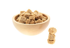 Brown sugar cubes in a wood bowl Royalty Free Stock Photo