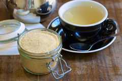 Brown sugar and a cup of green tea Royalty Free Stock Photos