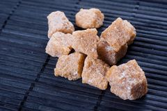 Brown sugar on dark background Royalty Free Stock Photography