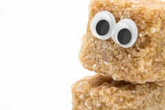 Brown sugar face. Brown sugar monster with googly eyes on white background Royalty Free Stock Images