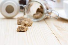 Brown sugar, a few pieces. Stock Photos