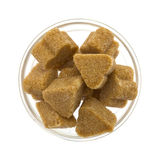 Brown sugar in a glass bowl. On white Royalty Free Stock Photography