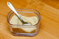 Brown sugar in glass bowl with spoon Stock Image