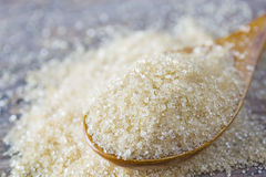 brown sugar heap and wooden spoon Stock Photo