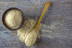 brown sugar heap and wooden spoon Royalty Free Stock Image