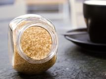 Brown sugar in jar royalty free stock images