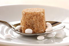 Brown sugar lump and artificial sweetener. Food, gastronomy, cooking,cookery Royalty Free Stock Image