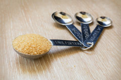 Brown sugar on measuring spoons Royalty Free Stock Photo