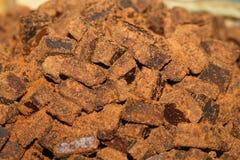 Brown sugar. Piles of Chinese Yunnan Manual of brown sugar Stock Photos