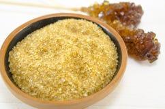 Brown sugar in a pot Stock Image