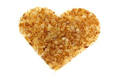 Brown sugar with a shape of heart Stock Image