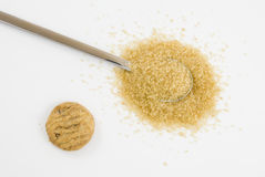 Brown sugar on silver teaspoon. With cookie isolated on white background Stock Image