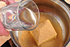 Brown sugar and some ingredients in pot. Brown sugar and some ingredients in a pot Stock Photography