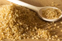 Brown sugar with a spoon Royalty Free Stock Photos