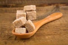 Brown sugar in spoon Stock Photos
