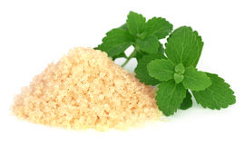 Brown sugar with stevia leaves Stock Photo