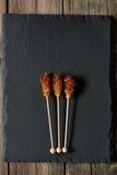 Brown sugar sticks Stock Images