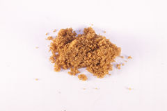 Brown sugar. Sweet brown sugar, on isolated, white background Stock Photo