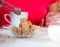 Brown sugar on  table at restaurant. Brown sugar on a table at restaurant Royalty Free Stock Images
