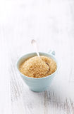 Brown Sugar in a Tea Cup Royalty Free Stock Photos